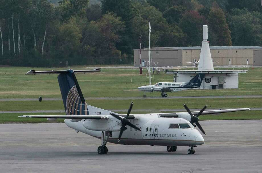 A Cape Air flight takes off in the background as a United Express arrives at the Albany International Airport Wednesday Oct. 10, 2017 in Colonie, N.Y. (Skip Dickstein/Times Union) Photo: SKIP DICKSTEIN / 20041820A