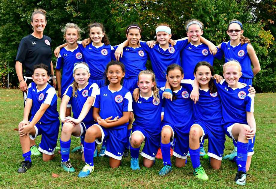 Norwalk Youth Soccer girls blue u-12 team poses for a photo after their Columbus Day Weekend tournament at Rocky Hill. Photo: John Nash / Hearst Connecticut Media / Norwalk Hour