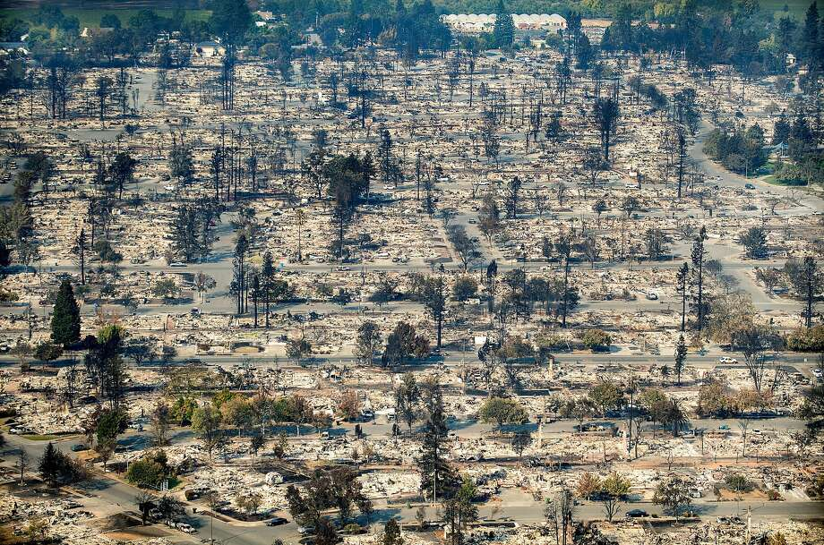 Homes leveled by the Tubbs fire line the Coffey Park neighborhood of Santa Rosa, Calif., on Wednesday, Oct. 11, 2017. Photo: Noah Berger, Special To The Chronicle