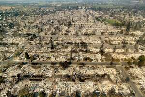 Homes leveled by the Tubbs fire line the Coffey Park neighborhood of Santa Rosa, Calif., on Wednesday, Oct. 11, 2017.