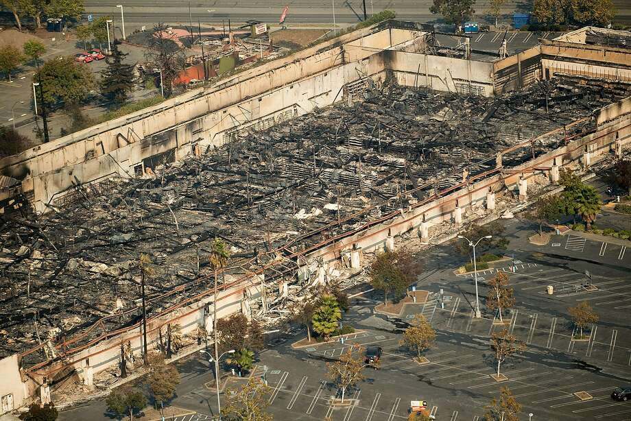 Rubble lines the interior of a K-mart store scorched by the Tubbs fire in Santa Rosa. Berkeley firefighters were told to stage at the K-mart, but when they arrived they found it fully engulfed in flames.  Photo: Noah Berger, Special To The Chronicle