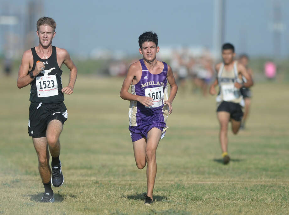 Midland's Lorenzo Mendez (right) finishes ninth place in the Boys Division I race with a time of 16:18.38 behind Big Spring's Cooper Miller during the Tall City Cross-Country Invitational on Saturday, Aug. 27, 2016, at the Rock the Desert festival field. James Durbin/Reporter-Telegram