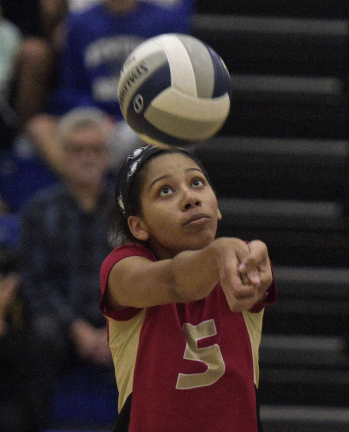Stratford's Sa'noma Smart (5) bumps the ball in the girls volleyball match between Stratford and Newtown high schools, Wednesday afternoon, October 11, 2017, at Newtown High School, in Newtown, Conn.
