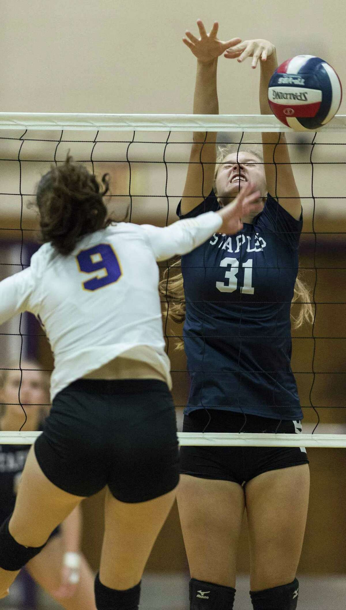 Staples High School against Westhill High School during a girls volleyball game played at Westhill High School, Wednesday, October 11, 2017.