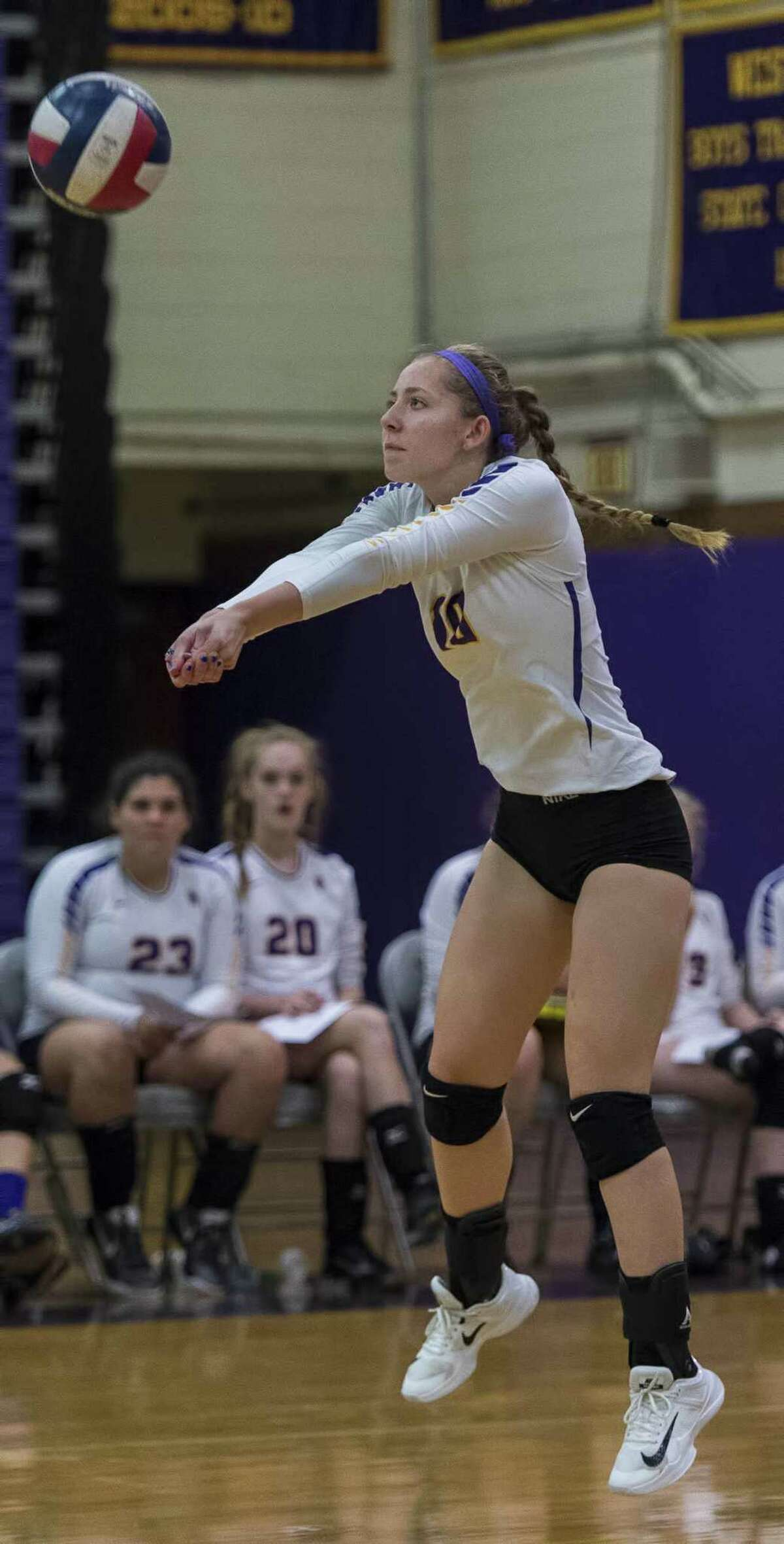 Westhill High School?'s Nikki Newcomer returns a serve during a girls volleyball game against Staples High School played at Westhill High School, Wednesday, October 11, 2017.
