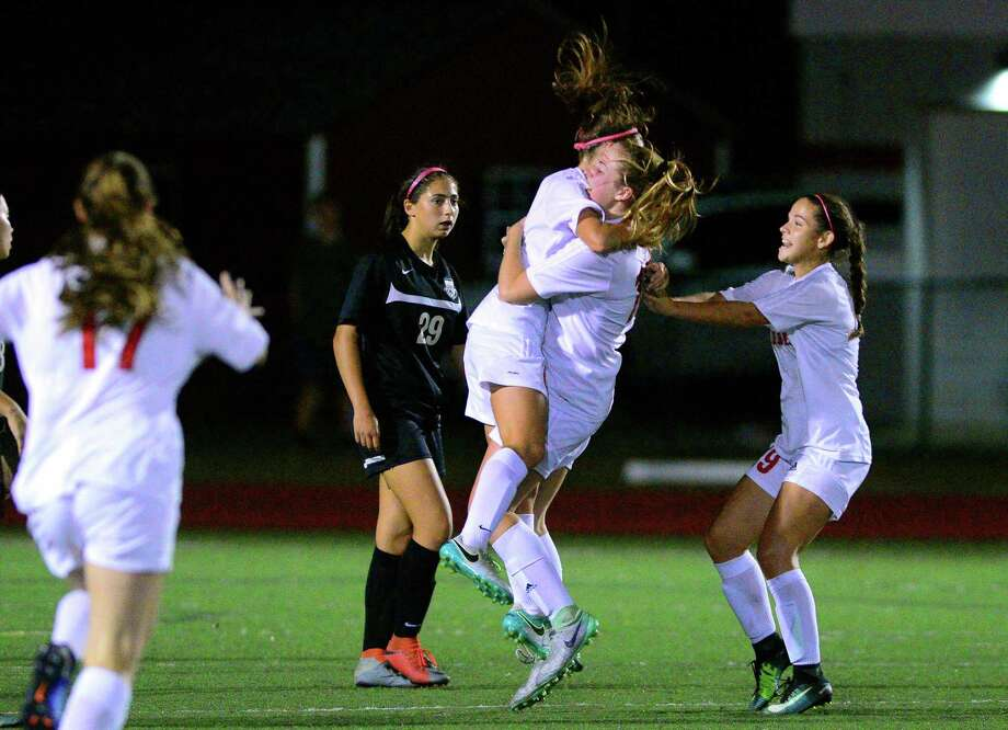 Teammates rush in to celebrate a goal by Fairfield Warde's Kaitlyn Walsh during girls soccer action against Trumbull in Fairfield, Conn., on Wednesday Oct. 11, 2017. Photo: Christian Abraham / Hearst Connecticut Media / Connecticut Post
