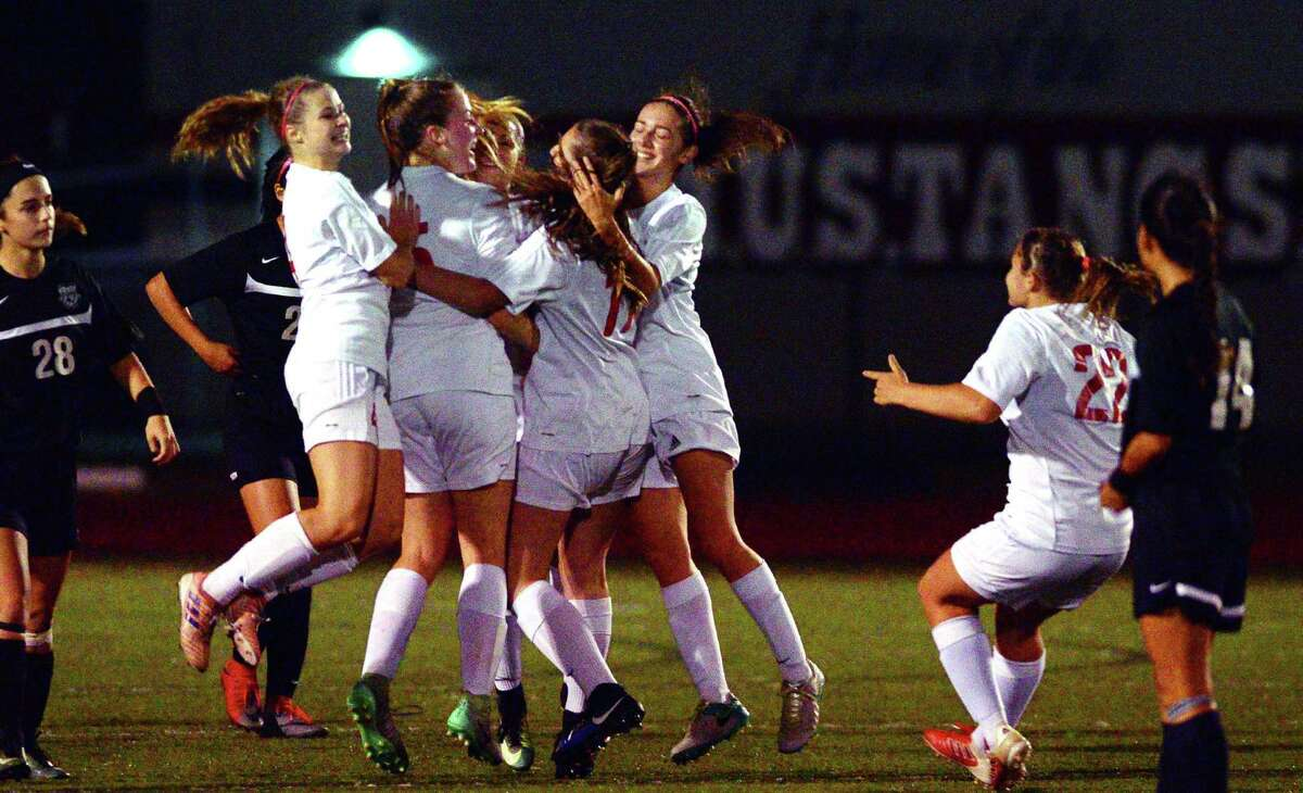 Teammates celebrate a goal by Fairfield Warde's Kaitlyn Walsh during girls soccer action against Trumbull in Fairfield, Conn., on Wednesday Oct. 11, 2017.