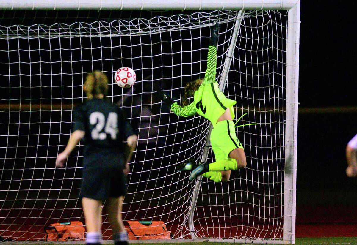 Trumbull goalkeeper Maryna Barone fails to stop a shot by Fairfield Warde's Clare Corcoran during girls soccer action in Fairfield, Conn., on Wednesday Oct. 11, 2017.