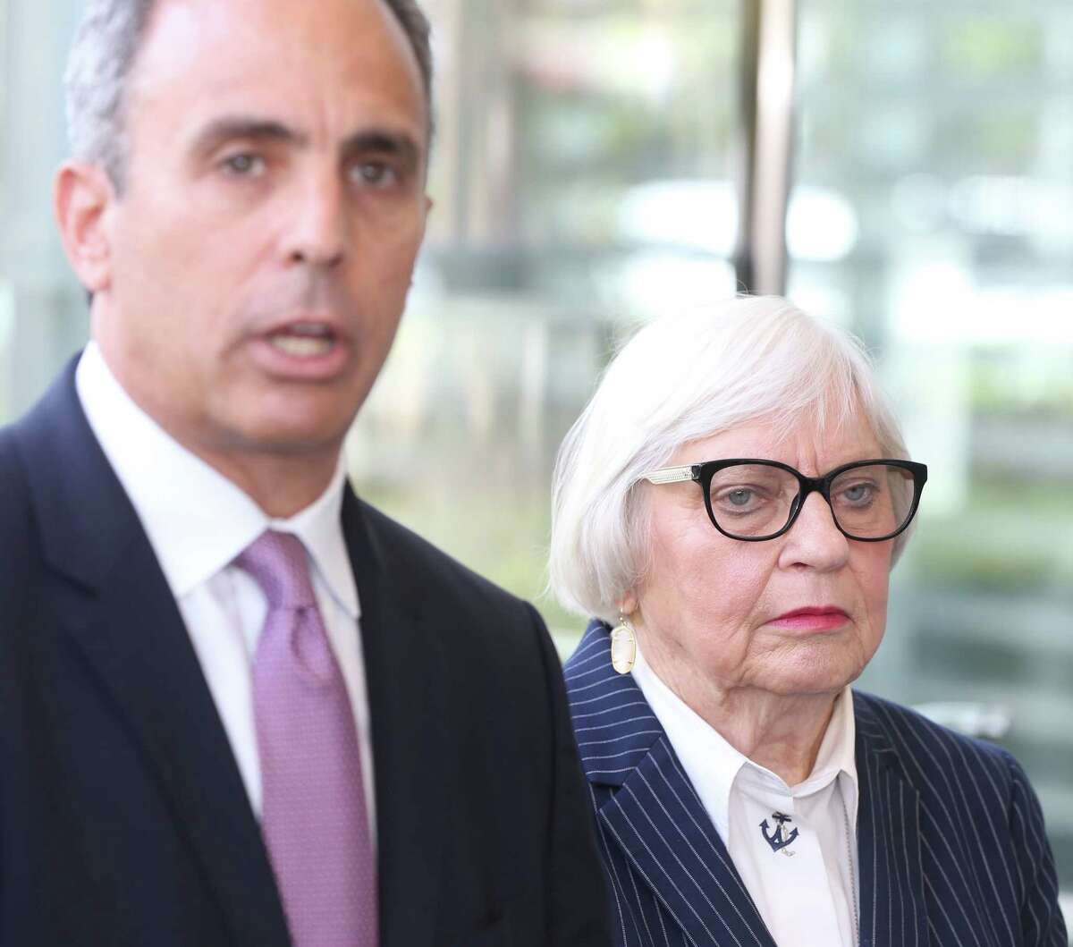 Bertie Simmons listens as her attorney, Scott Newar, speaks to the media at the Mickey Leland Federal Building, 1919 Smith St., about filing federal discrimination complaints shown Monday, Oct. 9, 2017. Bertie Simmons, the Furr High School principal, was placed on leave. ( Melissa Phillip / Houston Chronicle )