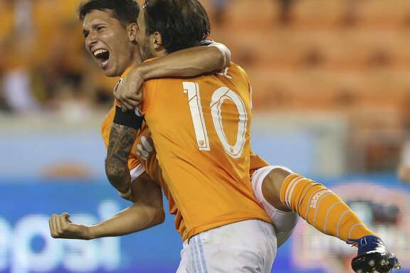 Houston Dynamo midfielder Tomas Martinez (25) celebrates his goal at the 63rd minute with Vicente Sanchez (10) during the second half of the MLS game at BBVA Compass Stadium Wednesday, Oct. 11, 2017, in Houston. Houston Dynamo defeated Sporting Kansas City 2-1. ( Yi-Chin Lee / Houston Chronicle )