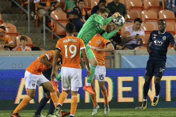 Houston Dynamo goalkeeper Tyler Deric (1) comes out of the box to get the ball away from Sporting Kansas City players during the second half of the MLS game at BBVA Compass Stadium Wednesday, Oct. 11, 2017, in Houston. Houston Dynamo defeated Sporting Kansas City 2-1. ( Yi-Chin Lee / Houston Chronicle )