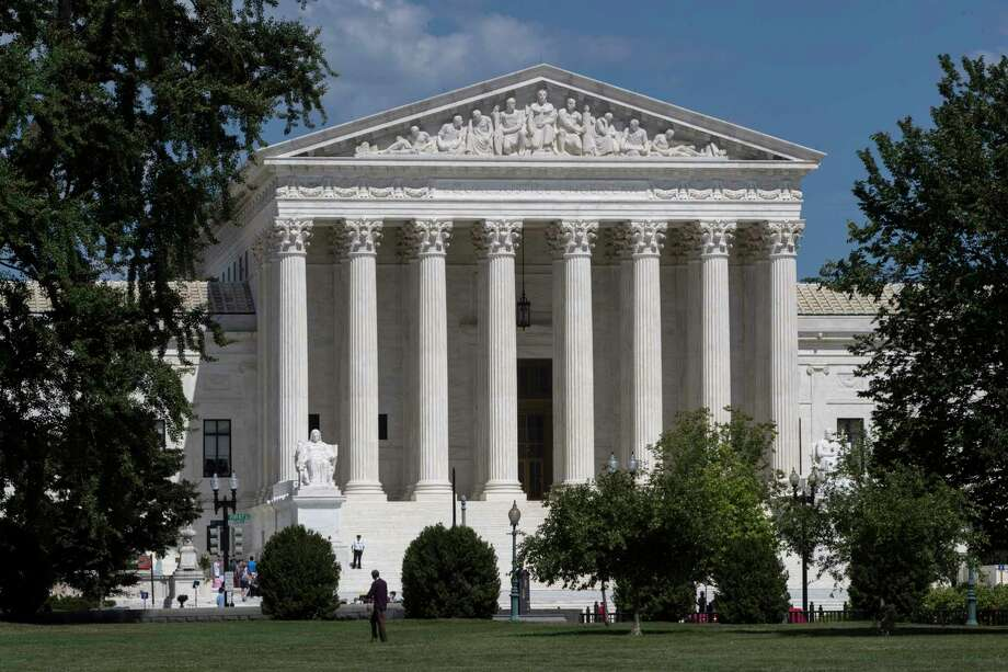 In this June 26, 2017 file photo, The Supreme Court is seen in Washington. Some of America's most well-known companies are urging the Supreme Court to decide whether a federal law prohibits sexual discrimination based on a person's sexual orientation. They ultimately want the court to rule that the law covers sexual orientation discrimination, a position opposite that taken by the Trump administration. The 76 companies and organizations filed a brief Wednesday encouraging the high court to hear a case out of Georgia involving a gay security officer.   (AP Photo/J. Scott Applewhite) Photo: J. Scott Applewhite, STF / Copyright 2017 The Associated Press. All rights reserved.
