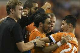 Houston Dynamo players and midfielder Tomas Martinez (25) celebrate Martinez's free kick that resulted to Sporting Kansas City's own goal during the second half of the MLS game at BBVA Compass Stadium Wednesday, Oct. 11, 2017, in Houston. Houston Dynamo defeated Sporting Kansas City 2-1. ( Yi-Chin Lee / Houston Chronicle )