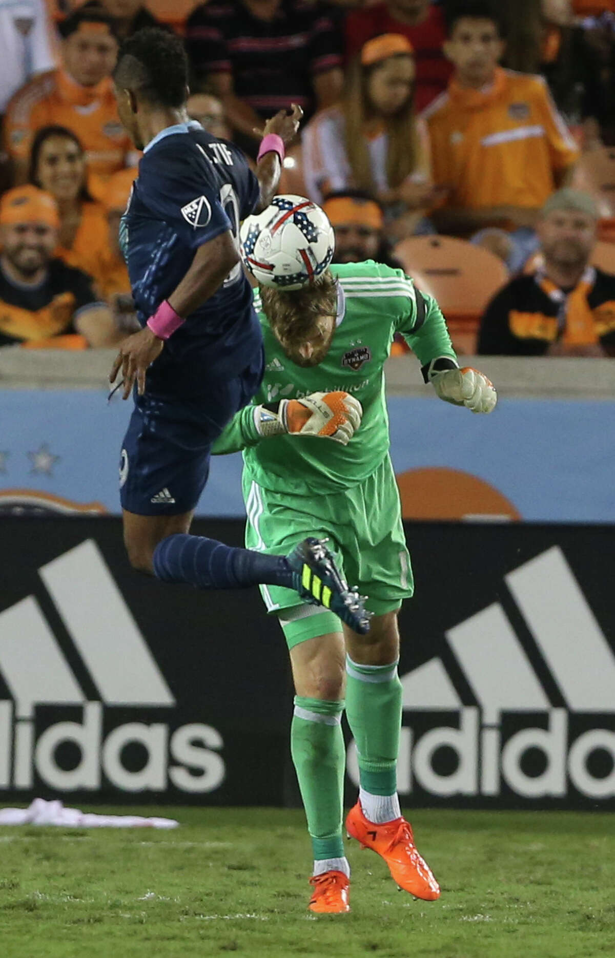 Houston Dynamo goalkeeper Tyler Deric (1) attempts a header to get the ball away from Sporting Kansas City forward Latif Blessing (9) during the second half of the MLS game at BBVA Compass Stadium Wednesday, Oct. 11, 2017, in Houston. Houston Dynamo defeated Sporting Kansas City 2-1. ( Yi-Chin Lee / Houston Chronicle )