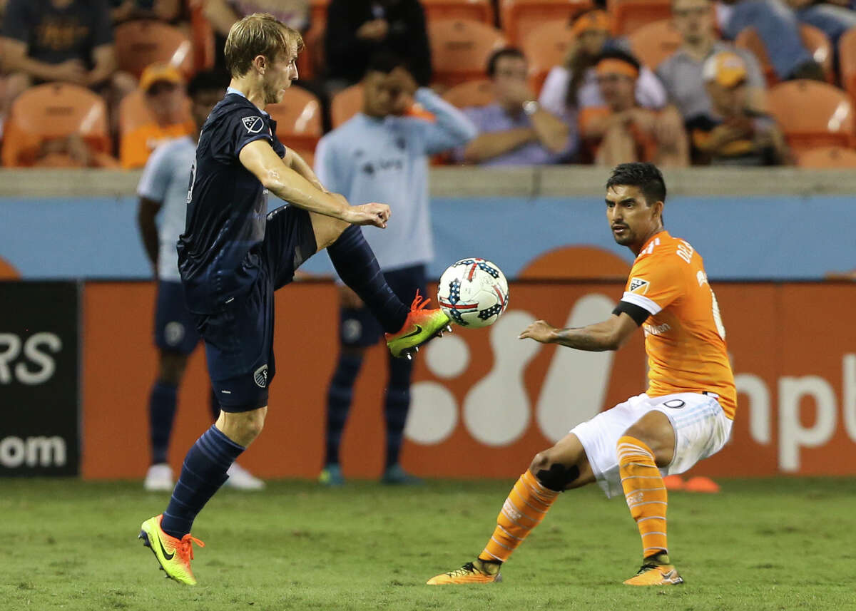 Houston Dynamo defender A. J. DeLaGarza (20) defensing Sporting Kansas City defender Seth Sinovic (15) during the second half of the MLS game at BBVA Compass Stadium Wednesday, Oct. 11, 2017, in Houston. Houston Dynamo defeated Sporting Kansas City 2-1. ( Yi-Chin Lee / Houston Chronicle )