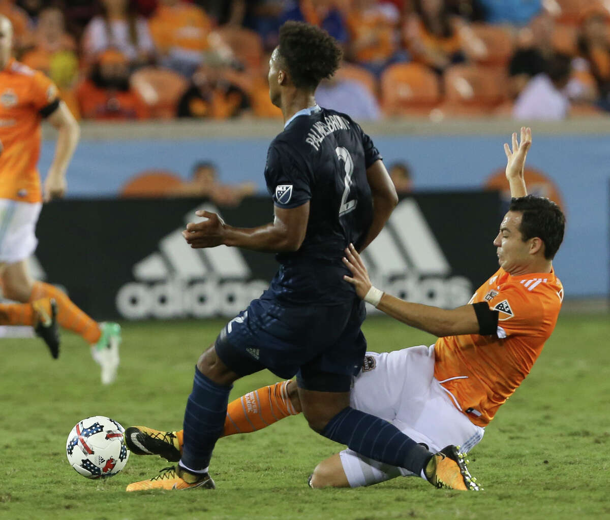 Houston Dynamo forward Erick Torres (9) tackles Sporting Kansas City defender Erik Palmer-Brown (2) during the second half of the MLS game at BBVA Compass Stadium Wednesday, Oct. 11, 2017, in Houston. Houston Dynamo defeated Sporting Kansas City 2-1. ( Yi-Chin Lee / Houston Chronicle )