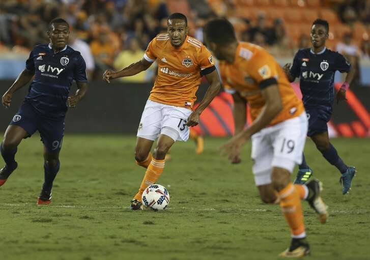 Houston Dynamo midfielder Ricardo Clark (13) looks at forward Mauro Manotas (19) for a pass during the first half of the MLS game against the Sporting Kansas City at BBVA Compass Stadium Wednesday, Oct. 11, 2017, in Houston. ( Yi-Chin Lee / Houston Chronicle )