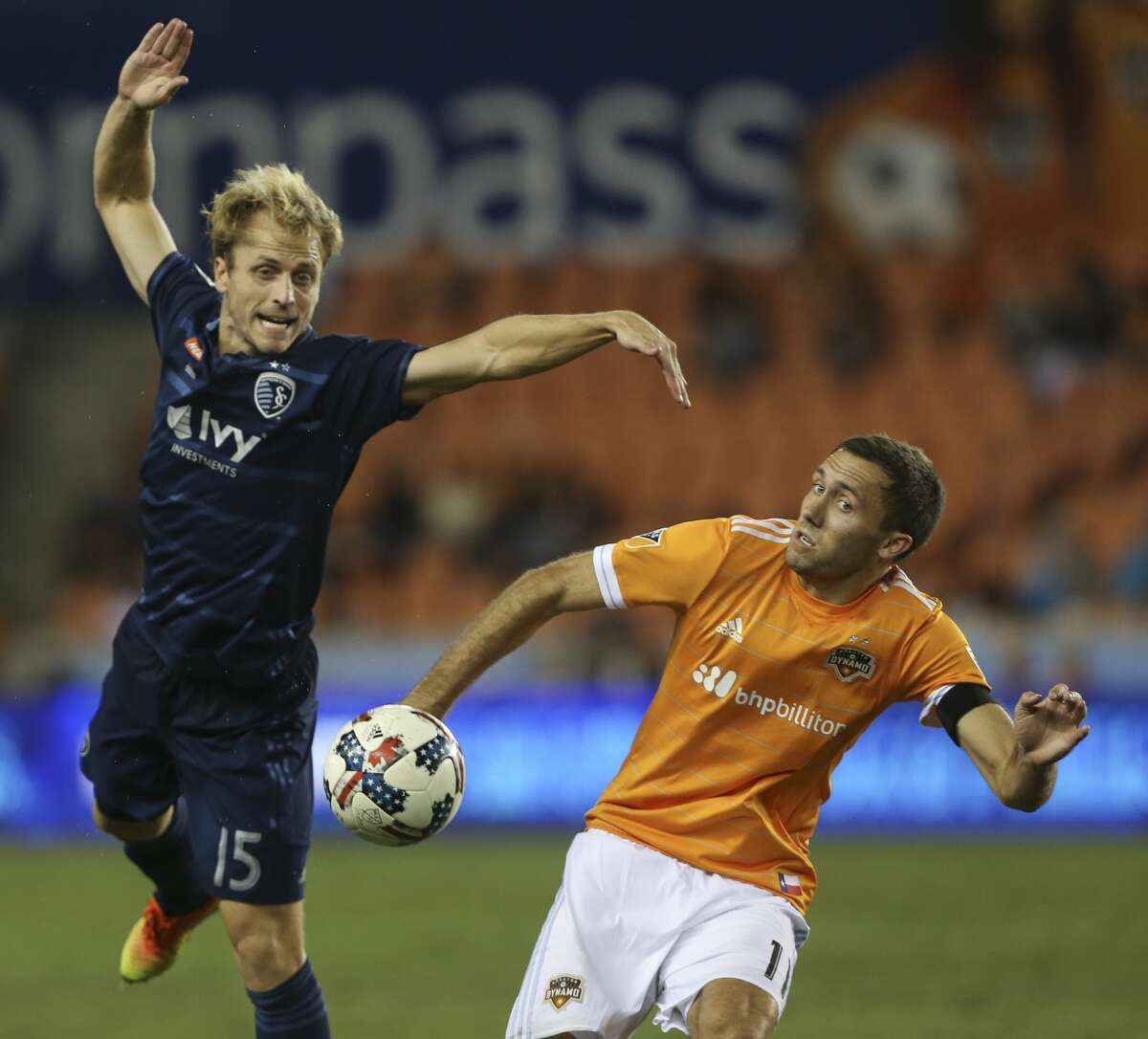 Houston Dynamo midfielder Andrew Wenger (11) and Sporting Kansas City defender Seth Sinovic (15) go after the ball during the second half of the MLS game at BBVA Compass Stadium Wednesday, Oct. 11, 2017, in Houston. Houston Dynamo defeated Sporting Kansas City 2-1. ( Yi-Chin Lee / Houston Chronicle )
