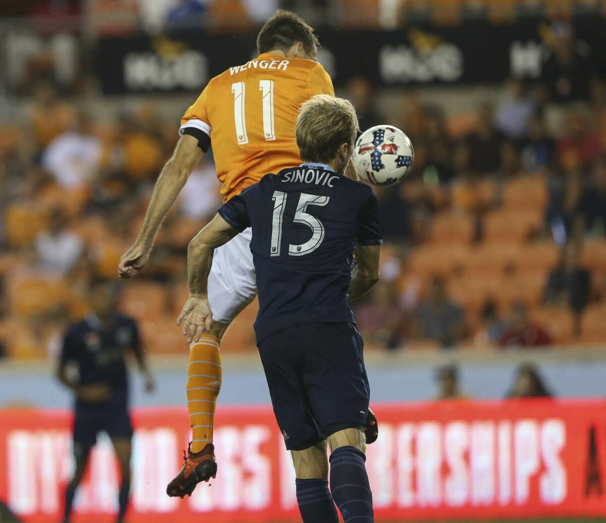 Houston Dynamo midfielder Andrew Wenger (11) attempts to score with a header during the second half of the MLS game at BBVA Compass Stadium Wednesday, Oct. 11, 2017, in Houston. Houston Dynamo defeated Sporting Kansas City 2-1. ( Yi-Chin Lee / Houston Chronicle )