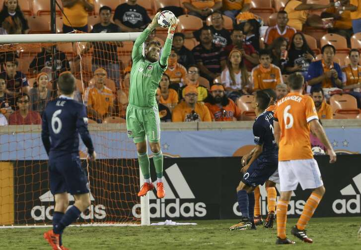 Houston Dynamo goalkeeper Tyler Deric (1) goes up to grab the ball during the second half of the MLS game at BBVA Compass Stadium Wednesday, Oct. 11, 2017, in Houston. Houston Dynamo defeated Sporting Kansas City 2-1. ( Yi-Chin Lee / Houston Chronicle )