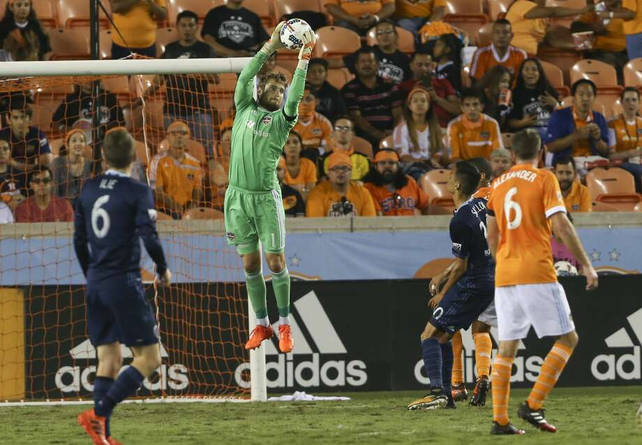 Houston Dynamo goalkeeper Tyler Deric (1) goes up to grab the ball during the second half of the MLS game at BBVA Compass Stadium Wednesday, Oct. 11, 2017, in Houston. Houston Dynamo defeated Sporting Kansas City 2-1. ( Yi-Chin Lee / Houston Chronicle ) Photo: Yi-Chin Lee/Houston Chronicle