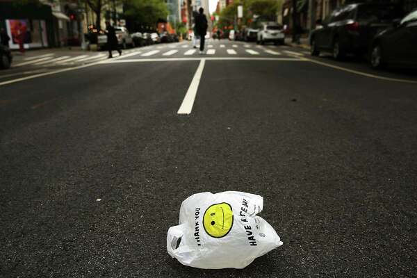 NEW YORK, NY - MAY 05: A plastic bag sits in a Manhattan street on May 05, 2016 in New York City. New York's City Council is scheduled to vote Thursday on a bill that would require most stores to charge five cents per bag in an effort to cut down on plastic waste. New York's sanitation department estimates that every year 10 billion bags are thrown in the trash. (Photo by Spencer Platt/Getty Images) ORG XMIT: 637182819