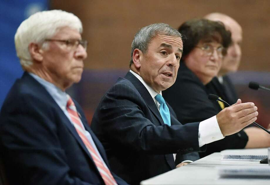Republican North Haven First Selectman Michael J. Freda, second from left, speaks about the town's declining population at a debate for first and second selectman Wednesday at the Recreation Center. Democratic challenger for first selectman is Alan Sturtz, at left, and Democrat Sally Buemi, third from left, is going up against candidate for second selectman, William Pieper, at right. Photo: Catherine Avalone / Hearst Connecticut Media / New Haven Register