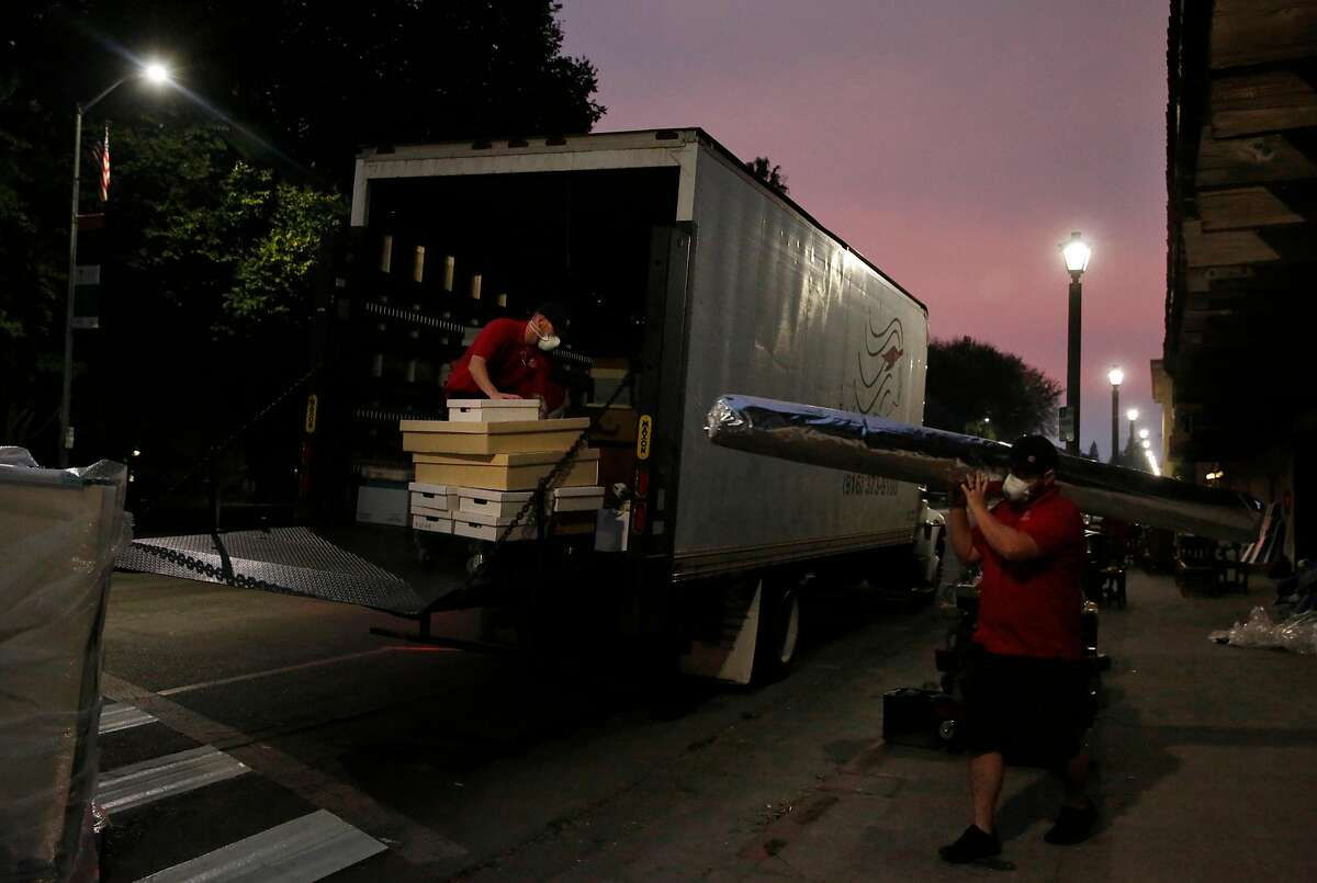 Workers move historic items from the Sonoma Barracks Oct. 11, 2017 in downtown Sonoma, Calif. California State Parks decided to move the items from the Barracks and Mission San Francisco Solano as a precautionary measure as fires burned beyond the town.