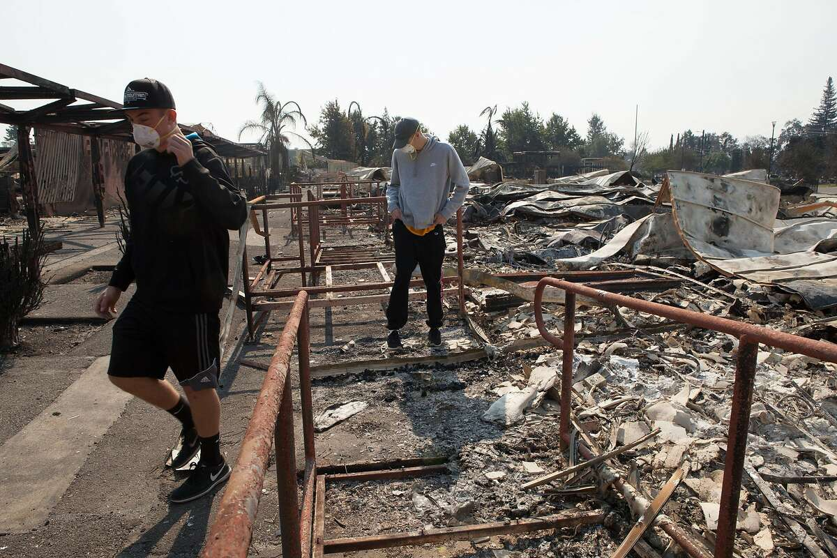 Seniors Deric Younce and Tyler Botteri (left to right) look through the damage Tubbs Fire inflicted on Cardinal Newman High School in Santa Rosa, Ca. on Wednesday, October 11, 2017. Both boys are athletes at the school.