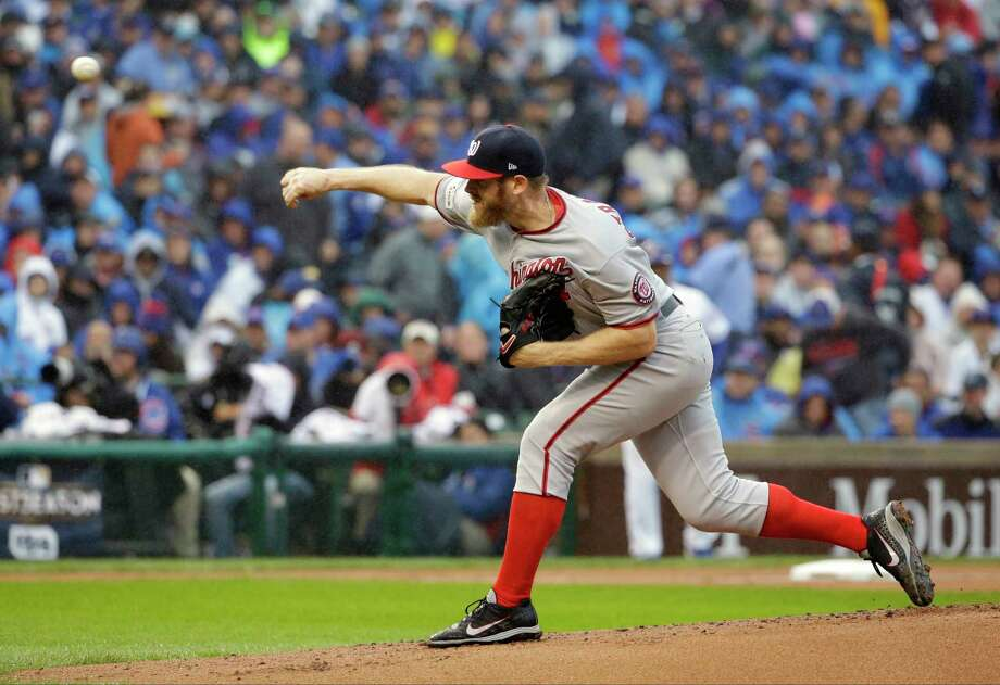 Washington Nationals starting pitcher Stephen Strasburg throws during the first inning of Game 4 of baseball's National League Division Series against the Chicago Cubs, Wednesday, Oct. 11, 2017, in Chicago. (AP Photo/Nam Y. Huh) ORG XMIT: CXC116 Photo: Nam Y. Huh / Copyright 2017 The Associated Press. All rights reserved.