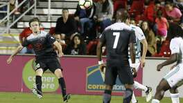 San Antonio FC's Greg Cochrane (20) attempts a shot against Portland Timber 2 during their game at Toyota Field on Wednesday, Oct. 11, 2017. SAFC defeated Portland, 2-1.