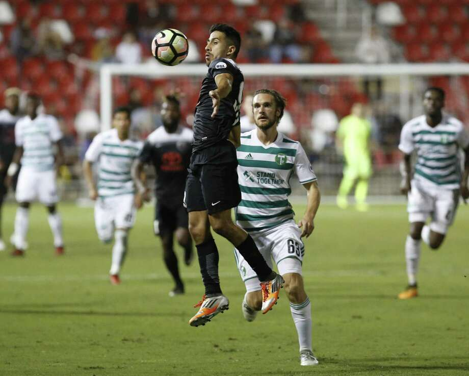 San Antonio FC's Ever Guzman (99) gains control of the ball against Portland Timber 2's Kyle Bjornethun (63) during their game at Toyota Field on Oct. 11. The possibility of an MLS team Austin likely means no such team here. Meanwhile, the team we do have is playing just fine. Photo: Kin Man Hui /San Antonio Express-News / ©2017 San Antonio Express-News