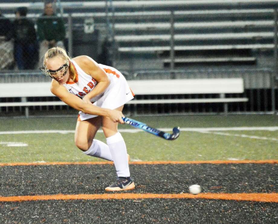 Edwardsville's Mattie Norton delivers a pass to a teammate from midfield during the second half of Wednesday's game against St. Joseph's Academy.