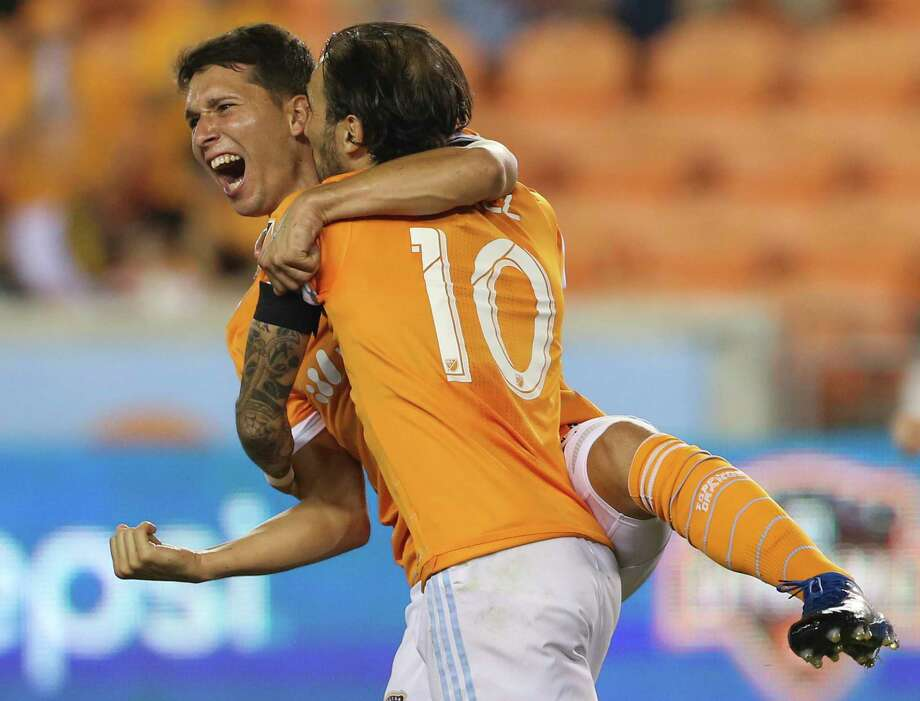 Houston Dynamo midfielder Tomas Martinez (25) celebrates his goal at the 63rd minute with Vicente Sanchez (10) during the second half of the MLS game at BBVA Compass Stadium Wednesday, Oct. 11, 2017, in Houston. Houston Dynamo defeated Sporting Kansas City 2-1. ( Yi-Chin Lee / Houston Chronicle ) Photo: Yi-Chin Lee, Houston Chronicle / © 2017  Houston Chronicle