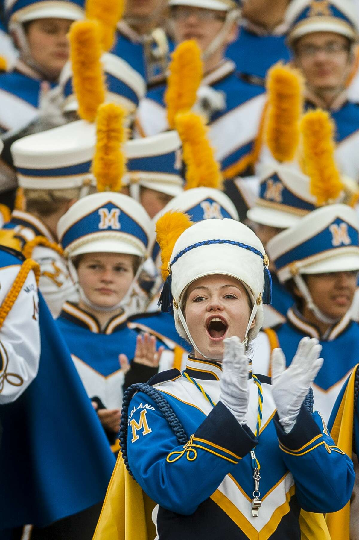 Members of the Midland High School marching band applaud another band during the 2017 Midland Marching Band Showcase on Wednesday, Oct. 11, 2017 at Midland Community Stadium. (Katy Kildee/kkildee@mdn.net)
