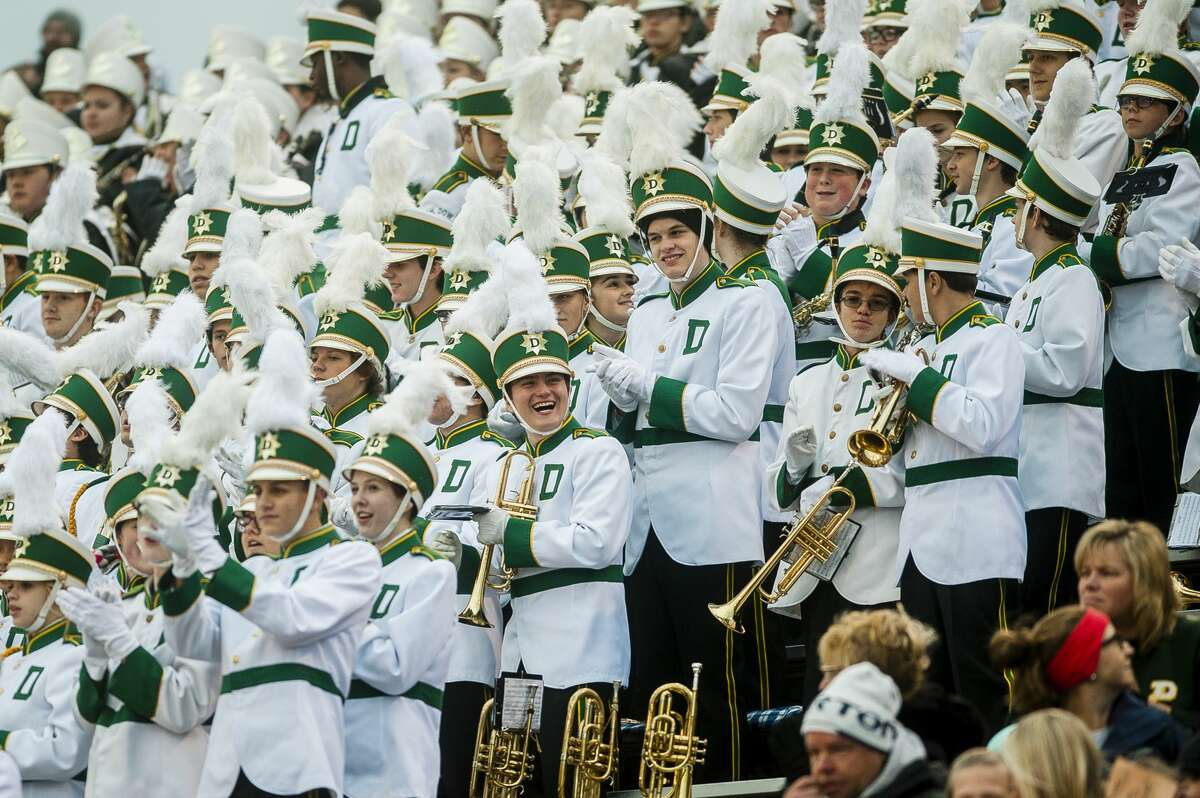Members of the Dow High School marching band applaud another band during the 2017 Midland Marching Band Showcase on Wednesday, Oct. 11, 2017 at Midland Community Stadium. (Katy Kildee/kkildee@mdn.net)