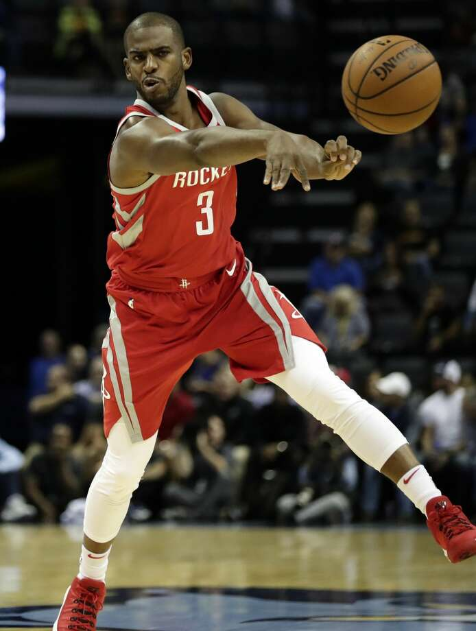 Houston Rockets guard Chris Paul (3) passes against the Memphis Grizzlies in the first half of an NBA preseason basketball game on Wednesday, Oct. 11, 2017, in Memphis, Tenn. (AP Photo/Rogelio V. Solis) Photo: Rogelio V. Solis/Associated Press