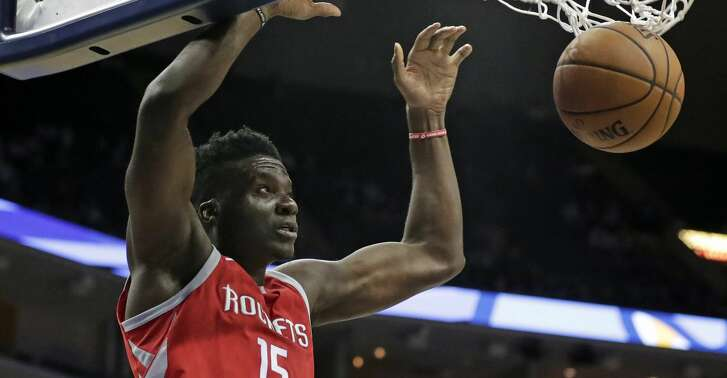 Houston Rockets center Clint Capela (15) watches his dunk go through the net in the first half of an NBA preseason basketball game against the Memphis Grizzlies on Wednesday, Oct. 11, 2017, in Memphis, Tenn. (AP Photo/Rogelio V. Solis)