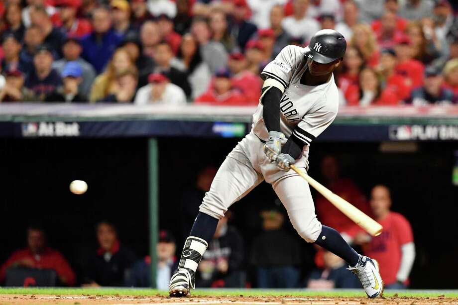 CLEVELAND, OH - OCTOBER 11:  Didi Gregorius #18 of the New York Yankees hits a two-run homerun in the third inning against the Cleveland Indians in Game Four of the American League Divisional Series at Progressive Field on October 11, 2017 in Cleveland, Ohio.  (Photo by Jason Miller/Getty Images) ORG XMIT: 775053732 Photo: Jason Miller / 2017 Getty Images
