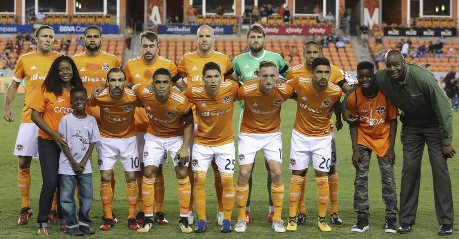 PHOTOS: Dynamo 2, Sporting Kansas City 1Houston Dynamo starting XI poses for a photo before taking on Sporting Kansas City for the MLS game at BBVA Compass Stadium Wednesday, Oct. 11, 2017, in Houston. ( Yi-Chin Lee / Houston Chronicle )Browse through the photos to see action from the Dynamo's win over Sporting KC on Wednesday night. Photo: Yi-Chin Lee/Houston Chronicle