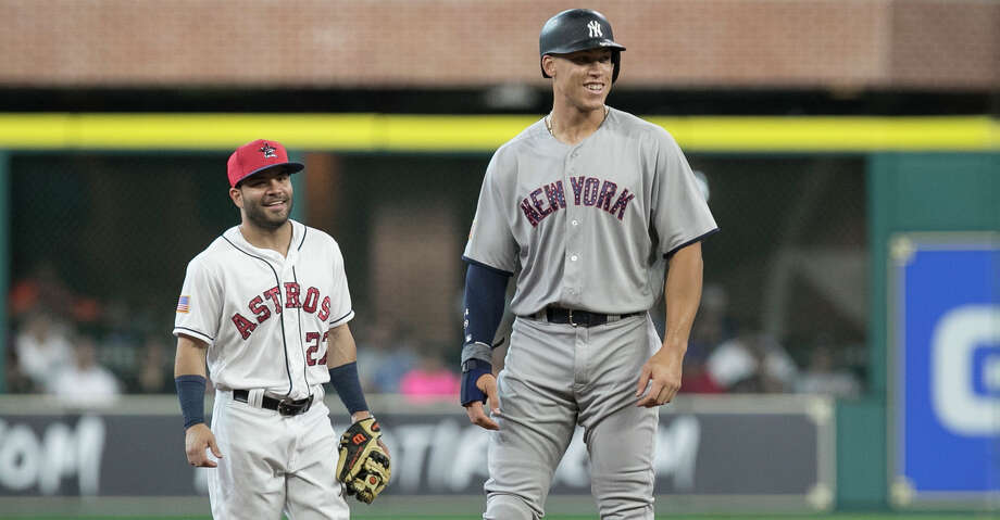 New York Yankees' Aaron Judge, right, and Houston Astros second baseman Jose Altuve have a conversation during the first inning of a baseball game, Sunday, July 2, 2017, in Houston. Both players have been elected to start in the All-Star Game in Miami on July 12, 2017.  (Yi-Chin Lee/Houston Chronicle via AP) Photo: Yi-Chin Lee/Associated Press