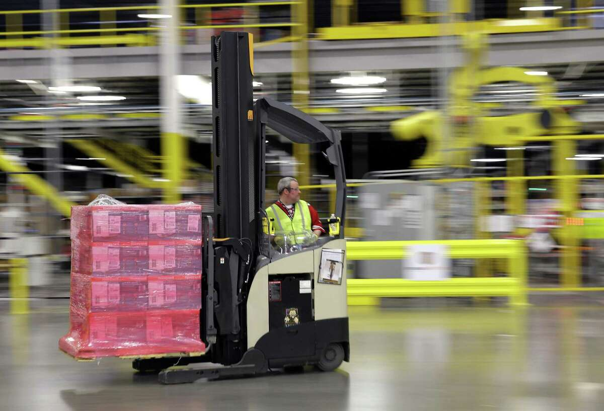Amazon is hiring 120,000 workers for the 2017 holiday season, with the company having Connecticut sorting and distribution centers in Wallingford and Windsor and plans to add a third in North Haven in 2018 or 2019. (AP Photo/Ted S. Warren, File)