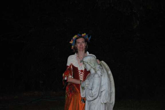 At a previous Histor-Ween, Stacy Pagel portrays the angel who guards the grave of Thomas Leverton. The angel tells event guests of the legend of how the statue emits an eerie blue glow and spins in the dead of night and how it holds as grudge against thieves who took it in the late 1970s. The statue was returned to the site in 1994 based on an anonymous tip.