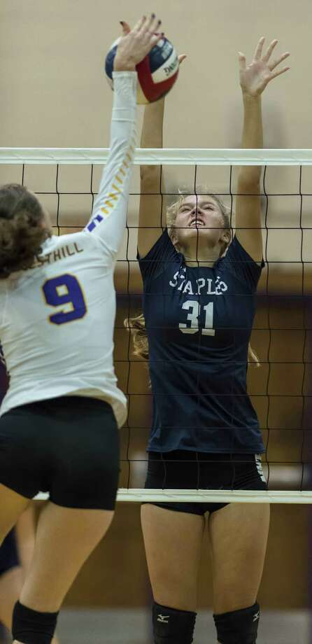 Staples High School's Brianna Dwyer jumps up to try to block the ball during a girls volleyball game against Westhill High School played at Westhill High School, Wednesday, October 11, 2017. Photo: Mark Conrad / For Hearst Connecticut Media / Connecticut Post Freelance