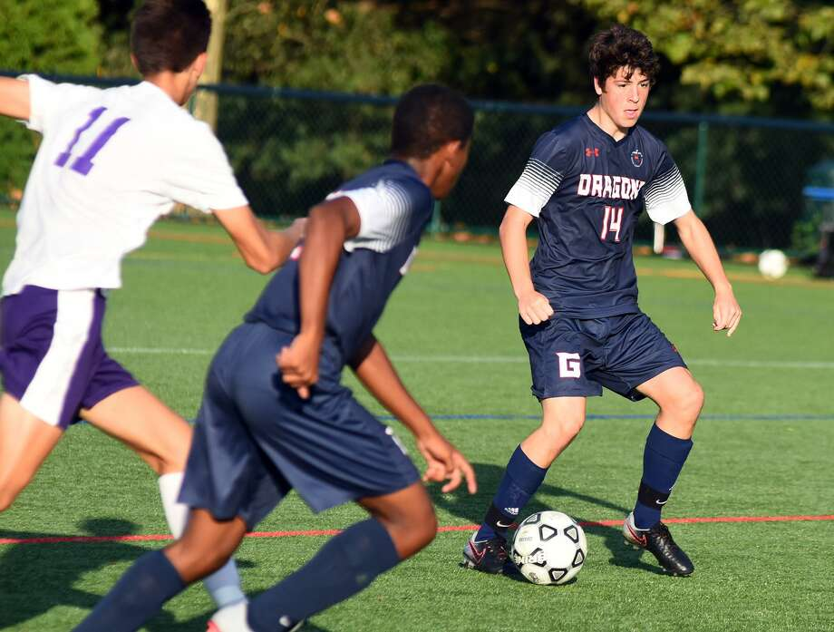 The Greens Farms Academy boys soccer team stunned The Masters School 1-0 last Friday, scoring the game-winning goal in the final seconds. Miles Mcdonald, who scored the goal, looks for room to manuever during the game. Photo: Contributed Photo