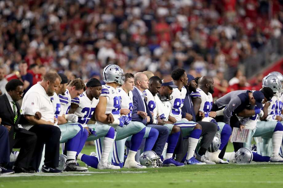 A Dallas union has filed charged against the Cowboys over remarks made by its owner Jerry Jones threatening to bench players who knelt during the national anthem. This photo shows Jones kneeling Sept. 25 before the anthem was played.Swipe through to see photos of other players kneeling during the national anthem this season. Photo: Christian Petersen/Getty Images