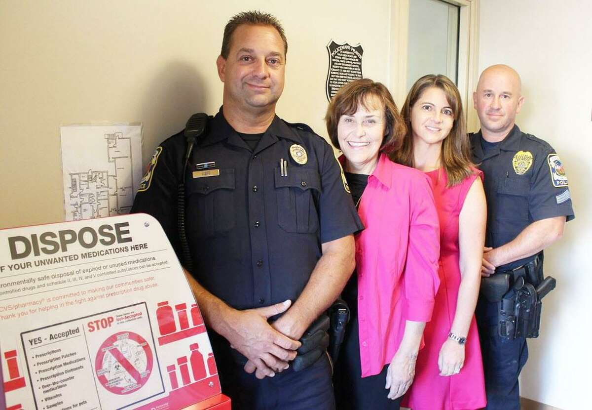 From left, Portland Police Officer Paul Liseo, First Selectwoman Susan Bransfield, state Rep. Christie Carpino and Sgt. James Kelly show off the town's new drug return box.