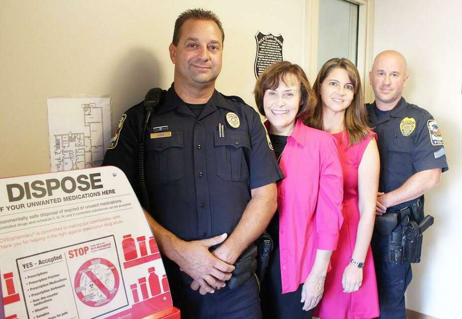 From left, Portland Police Officer Paul Liseo, First Selectwoman Susan Bransfield, state Rep. Christie Carpino and Sgt. James Kelly show off the town's new drug return box. Photo: Courtesy House Republicans