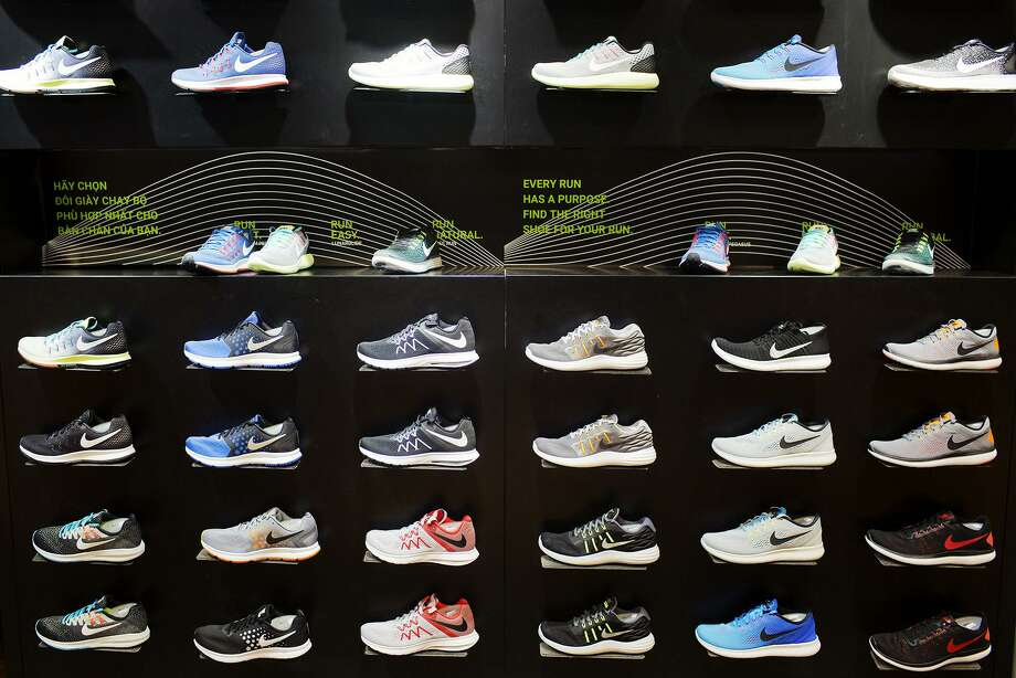 Footwear is displayed for sale in a Nike store at the Vincom Center shopping mall in Hanoi, Vietnam in January. The once high-flying U.S. sneaker and sports apparel industry's slump has deepened this year. Nike's sales in North America fell 3 percent last quarter, and it forecast another decline for the current one. Photo: Maika Elan /Bloomberg / Bloomberg