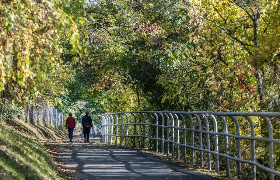 People walk the bike trail in the Corning Preserve in Albany, NY, on a beautiful Thursday, Oct. 12, 2017. (Skip Dickstein/Times Union) Photo: Skip Dickstein/Times Union